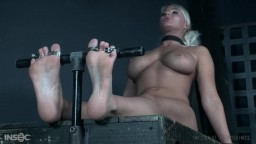 Foot torture for blonde woman