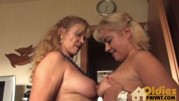 Two mature blonde lesbians having fun